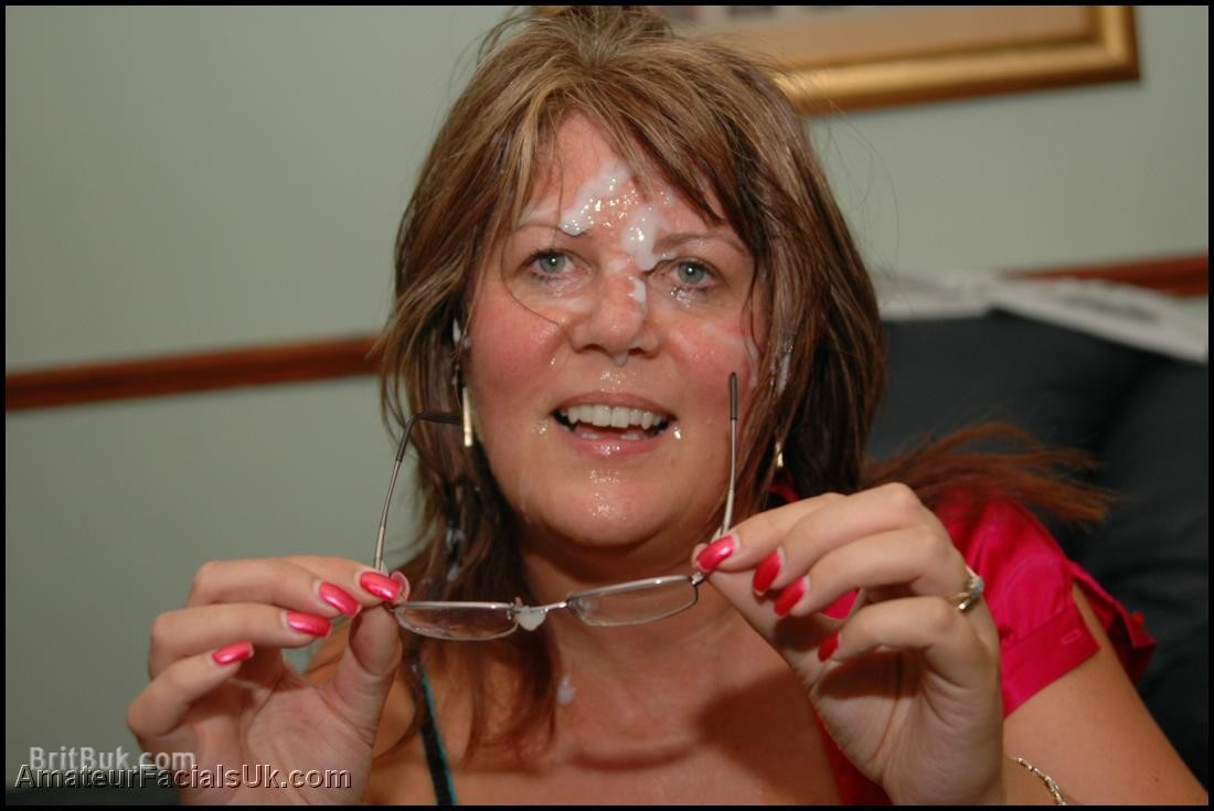 sexy sandy milf with cum on her glasses