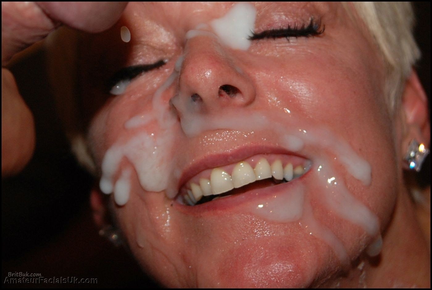 SemenFacialsandSmiles UKBukkakeQueen012 Painting Her Face with Cum. A Bukkake Work of Art.