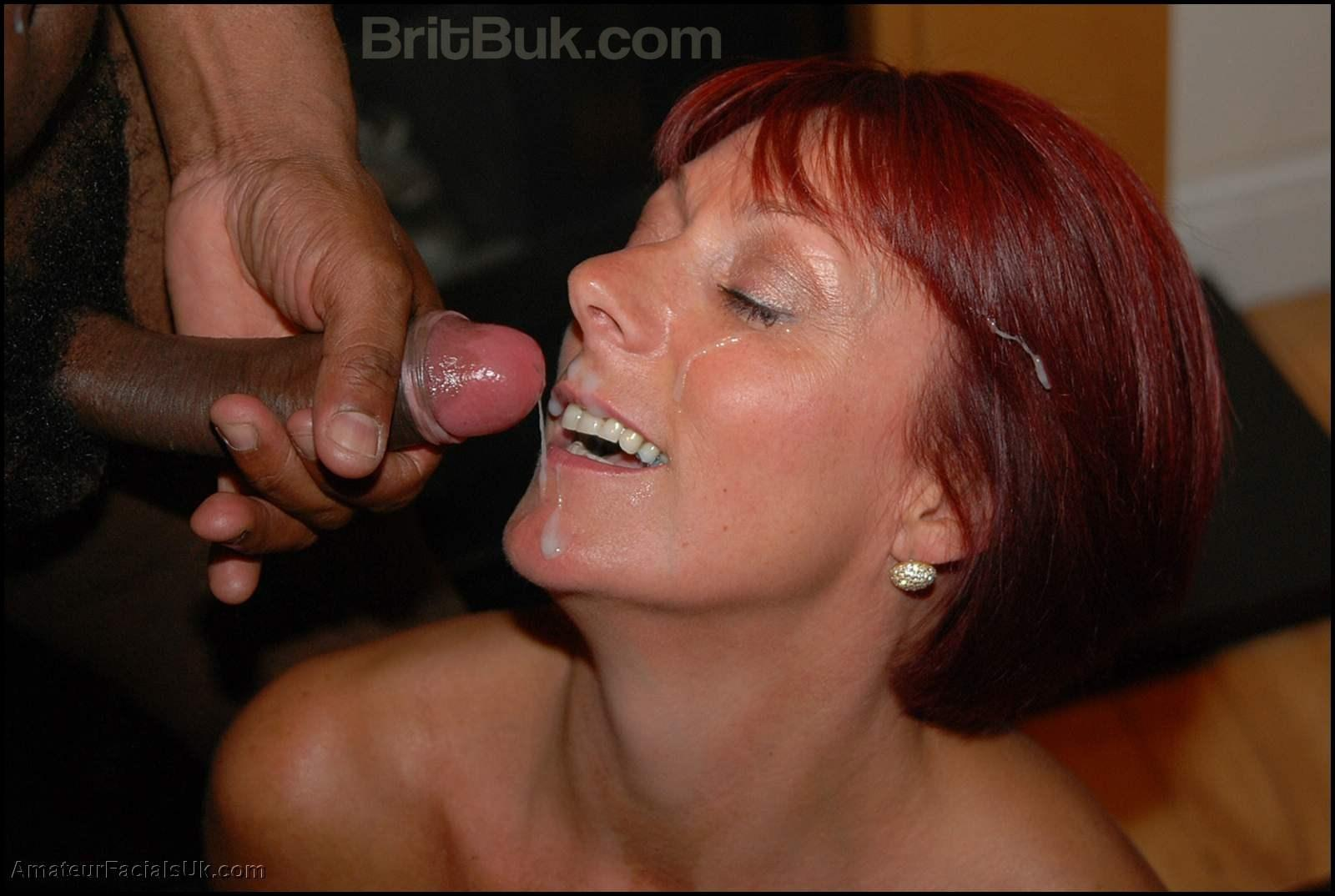jade with red hair taking a semen facial shot from AFUK bukkake update july 2013